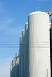 Brewery tanks blue sky big containers beer production industry Stock Photo