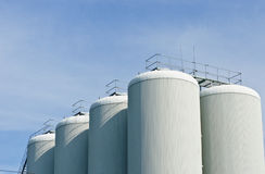 Brewery tanks blue sky big containers beer production industry Stock Photos