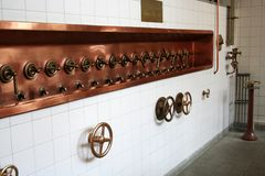 Brewery taps. A line of beer taps at a brewery Royalty Free Stock Photography