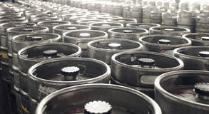 Brewery warehouse. With dozen of beer kegs Royalty Free Stock Photo