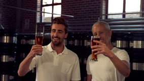 Brewery workers toasting with a pint stock footage