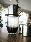 Brewing. A fresh brewing coffee in a glass Royalty Free Stock Images