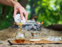 Brewing Chinese tea straits in the woods near the fire stock photos