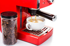 Brewing coffee with a bright red color espresso coffee machine Royalty Free Stock Photos