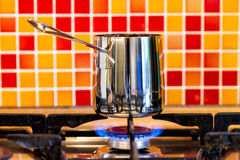 Brewing coffee in inox cezve on a gas stove Royalty Free Stock Photos