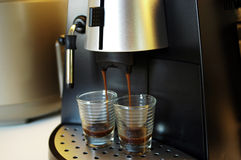 Brewing Espresso. Espresso coffee in the making. Intentional Selective focus Royalty Free Stock Image