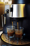 Brewing Espresso. Espresso coffee in the making Royalty Free Stock Photography