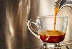 Brewing espresso. Closed ou of espresso machine brewing a coffee in to a cup Stock Photos