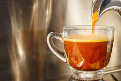 Brewing espresso. Closed ou of espresso machine brewing a coffee in to a cup Royalty Free Stock Image