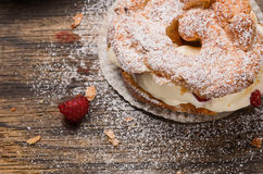 Brewing pies with cream and red berries Stock Photos