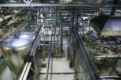Brewing production, workshop with steel tanks, pipes and machinery at modern beer factory. View from above royalty free stock image