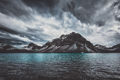 Brewing Storm at Bow Lake, Canada. Stormy clouds cover the mountains over Bow Lake in Alberta Canada on a summer day royalty free stock photos