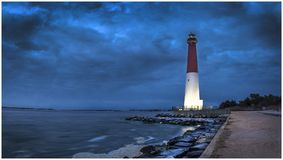 Brewing storm at Old Barney. Evening weather rolling in on Barnegat Lighthouse in Barnegat Light, New Jersey Stock Image