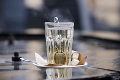 Brewing tea in a cup of boiling water. Royalty Free Stock Images