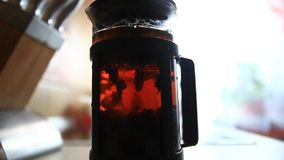Brewing tea in a teapot and blurred female hand stock video