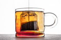 Brewing tea in the transparent cup horizontal Royalty Free Stock Photography