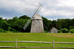 Brewster, MA: 18th Century Higgins Farm Windmill. The 18th century Higgins Farm Windmill with its four sails and c. 1795 Harris-Black House on Cape Cod in Stock Images