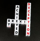 Brexit achieved by deception. Text brexit achieved by deception' in uppercase letters on small white cubes crossword style, black background stock photo