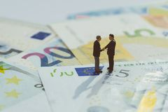Brexit agreement, Europe and UK economy deal, financial, investment or currency exchange concept, miniature businessman figurine stock image