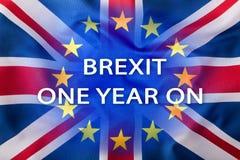 Brexit Bandeiras do Reino Unido e da União Europeia com texto um ano sobre Fotos de Stock Royalty Free