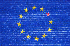 Brexit blue european union EU flag on brick wall and one star with great britain flag Royalty Free Stock Image