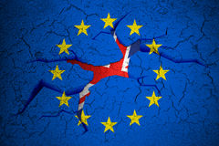 Brexit blue european union EU flag on broken crack wall with hole and uk england great britain flag inside Stock Photo