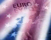 Brexit. British colors flag effect against euro banknote detail. Brexit concept. Unfocused Euro bill close up detail of Europe map with focus on Great Britain stock photography