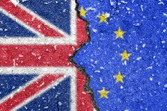 Brexit - British and EU flag cracked on the middle. Brexit - Half British flag and half EU flag split on the middle royalty free stock photography