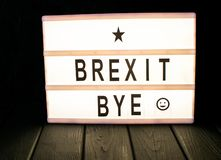 """Brexit bye"" text in lightbox. Money coin growth financial concept business bank investment background cash income debt profit wealth stack currency stock photo"