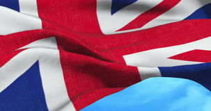 Brexit, closeup of waving flag of union jack, uk great britain england symbol, named united kingdom flag under blue sky. With clouds stock video