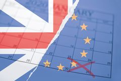Brexit concept background with torn British Union Jack and European Union flags with calendar with january 31 marked
