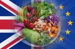 Brexit concept. A bowl of salad, with tomatoes, lettuce and peppers. With the flags of the Union Jack and the E.U over layered on royalty free stock photos