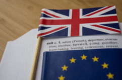 Brexit Concept: British and EU flags on a dictionary page emphasizing the word exit Stock Images