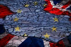 Abstract dry earth background with EU and UK flag. Brexit concept - EU and UK flag on grunge background stock photo