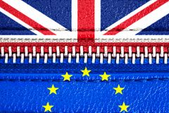 Brexit concept: European Union EU and United Kingdom UK flags connected via a closed zipper. Symbol of UK Brexit. stock photo