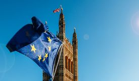 Brexit concept with European union flag juxtapositioned against Victoria tower, Westminster, London, UK.  royalty free stock images