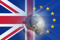 Brexit concept. A hand holding a globe focusing on North America. With the flags of the Union Jack and the E.U over layered on top royalty free illustration