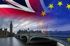 BREXIT conceptual image of London image and UK and EU flags ove