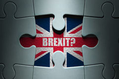 Brexit concept. Missing piece from a jigsaw puzzle revealing the British flag and Brexit question stock images
