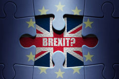 Brexit concept puzzle. Missing piece from a European jigsaw puzzle revealing British flag and Brexit question royalty free stock photo