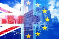 brexit concept - UK economy after Brexit deal - double exposure of flag and Canary Wharf business center skyscrapers royalty free stock photo
