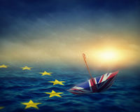 Brexit concept. Umbrella with the flag of the United Kingdom and sea with the flag European Union.Brexit concept Stock Image