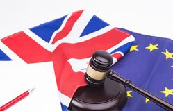 Brexit Contract. Brexit UK EU legal concept, different position theme with wooden judge gavels on table and flags royalty free stock photography