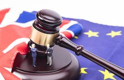 Brexit Deals. Brexit UK EU legal concept, different position theme with wooden judge gavels on table and flags stock photos