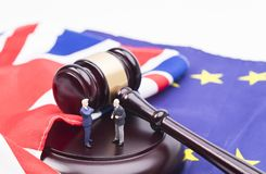 Brexit Deals. Brexit UK EU legal concept, different position theme with wooden judge gavels on table and flags royalty free stock photos