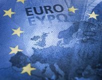 Brexit. European colors flag effect against euro banknote detail focus on Great Britain. Brexit concept. Unfocused Euro bill close up detail of Europe map with stock photo
