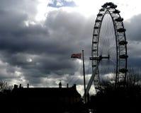Flag of the United Kingdom next to the London Eye. Brexit european union waterloo london eye british briton english england flag political government referendum royalty free stock images