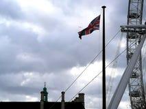 Flag of the United Kingdom next to the London Eye. Brexit european union waterloo london eye british briton english england flag political government referendum royalty free stock photo