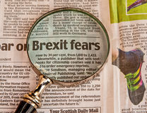 Brexit fears. Text Brexit fears in a popular newspaper emphasized by use of an antique hand magnifier. Concept of referendum for Britain voting to leave the royalty free stock images