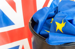Brexit. Flag of European Union in Dustbin with the Flag of the UK in background stock photography